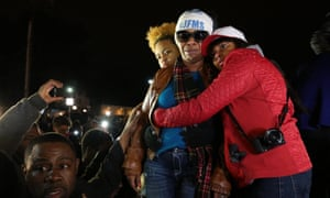 Lesley McSpadden, second from right, Michael Brown's mother, is comforted outside the Ferguson police department