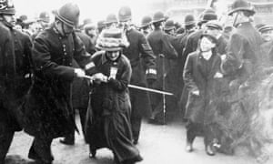 A suffragette struggling with a policeman on Black Friday, 18 November 1910.