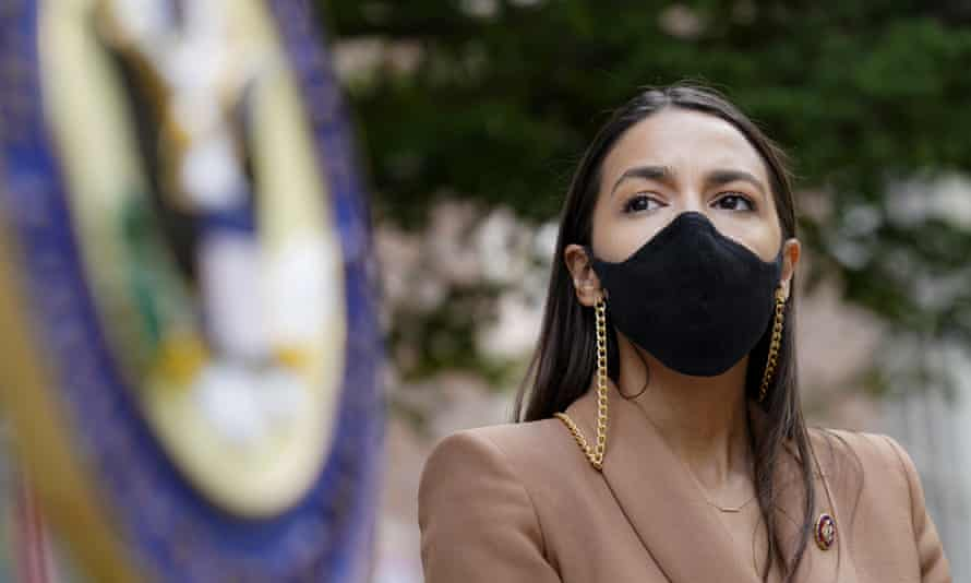 Alexandria Ocasio-Cortez in August. Donald Trump was impeached for inciting the Capitol attack and will face trial in the Senate.