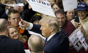 Donald Trump gestures to the crowd as he signs autographs at a campaign event at Plymouth State University Sunday.