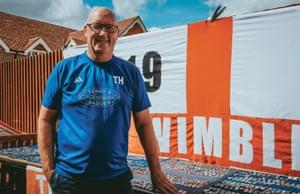 Terry poses beside his big AFC Wimbledon flag.
