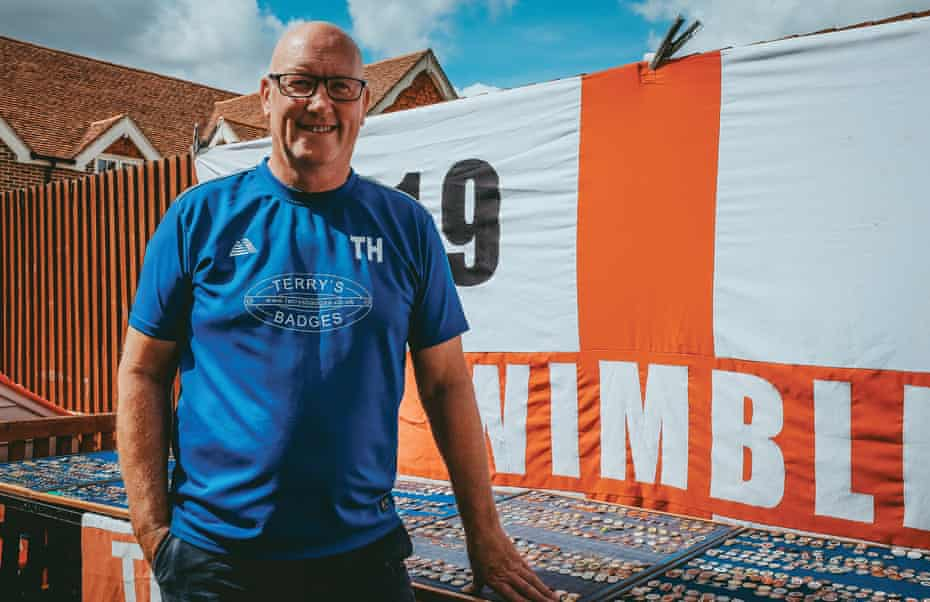 Terry poses beside his big AFC Wimbledon flag.