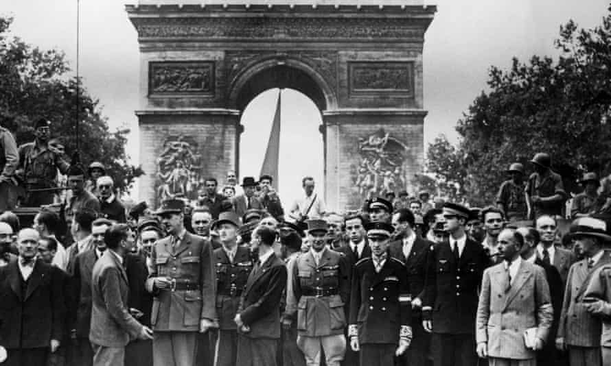 Prominent free French soldiers and politicians in front of the Arc de Triomphe, Paris, Including General de Gaulle (with cane), 26 August 1944.