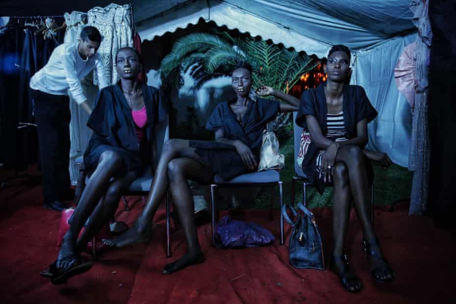 Models sit backstage during Dakar fashion week in June 2017