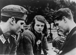 A picture taken on 23 July 1942 shows German resistance fighter Sophie Scholl, centre, with her brother Hans Scholl, left, and Christoph Probst.