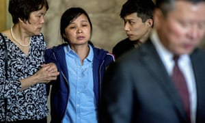 Yingying Zhang's mother Lifeng Ye, second from left, is supported by family members outside the court in Peoria.