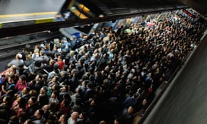 Commuters wait for the train at a subway station in downtown São Paulo