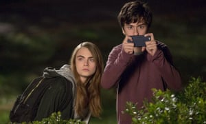 Cara Delevingne and Nat Wolff in Paper Towns.
