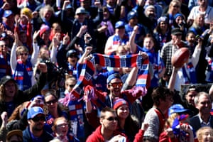 Bulldogs supporters celebrate their team's 2016 AFL premiership