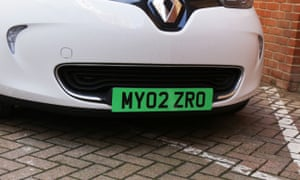An electric car with a green number plate.