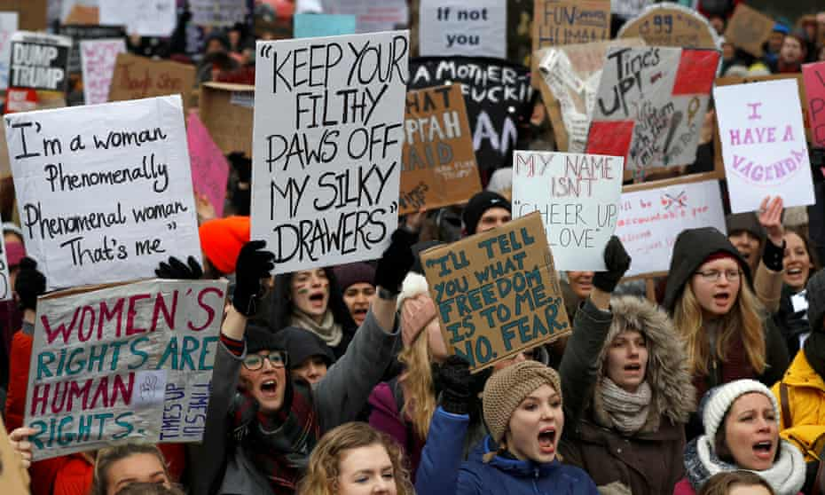 Women march at a protest in London