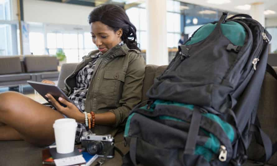 Woman with backpack and digital tablet in airport