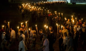 Non-Nazis, alt-correct, and white supremacists survive through the University of Virginia campus with torches in Charlottesville, Virginia, on August 11, 2017.