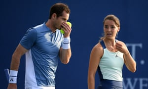 Andy Murray talks to his mixed doubles partner Jodie Burrage during their Battle of the Brits match.