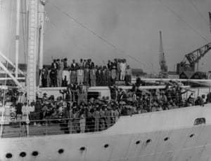 A ship carrying West Indian people arrives at Southampton docks in 1956
