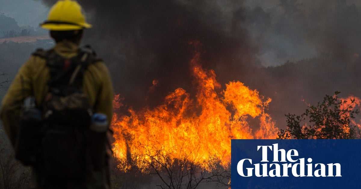 California wildfires death toll up to seven as huge blazes burn on – The Guardian