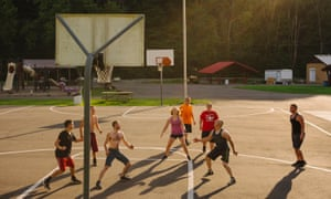 Young people play basketball on a summer afternoon in Webster Springs, West Virginia.