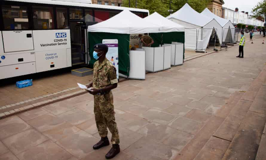 A soldier working at a Covid-19 vaccination point in Bolton, Greater Manchester