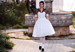 Model Kaia Gerber. The Grand Palais was turned into the garden of the abbey in Aubazine, central France, where Gabrielle 'Coco' Chanel grew up.