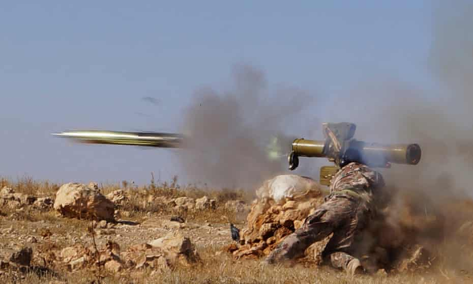 A Free Syrian army fighter fires an anti-tank missile in Syria.