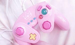 A pink Nintendo Gamecube controller.