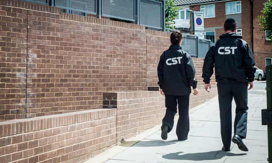 Community Security Trust staff on patrol at a school event.