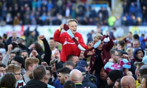 Burnley fans invade the pitch in celebration after promotion was secured.