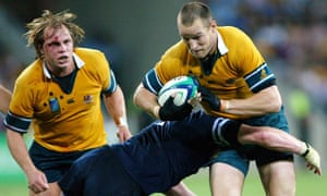 Stirling Mortlock in action, against Scotland in Brisbane during the 2003 World Cup.