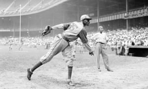 Kansas City Monarchs pitcher Satchel Paige warms up before a Negro League game between the Monarchs and the New York Cuban Stars
