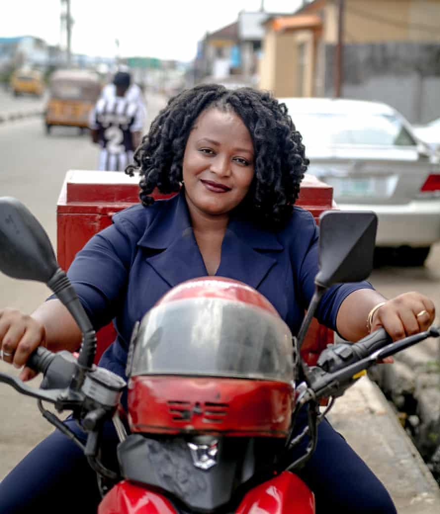 LifeBank CEO Temie Giwa-Tubosun mounts one of the company's bikes