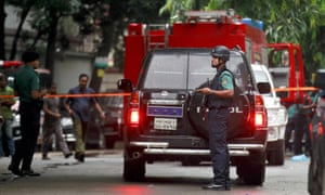 Bangladeshi security officers cordon off the area after heavily armed militants attacked the Holey Artisan cafe in Dhaka last month.