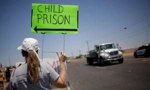A protester outside border patrol station facilities in Clint, Texas on 27 June 2019.