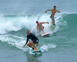 Florida, USSurfers takes advantage of waves churned up by Tropical Storm Isaias at Ocean Inlet Park.