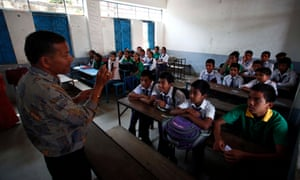 A teacher talks to students at a school reopened in Bhaktapur, Nepal