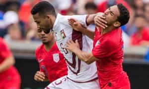 Venezuela midfielder Yangel Herrera handles Cristian Roldan during his team's win over the US