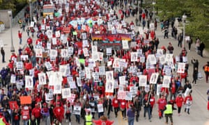 Teachers protest during a rally and march on the first day of a teacher strike in Chicago, Illinois, on 17 October.