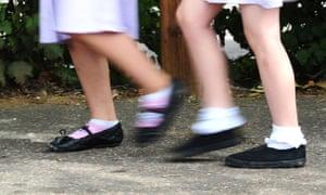 Two school girls walking to school.
