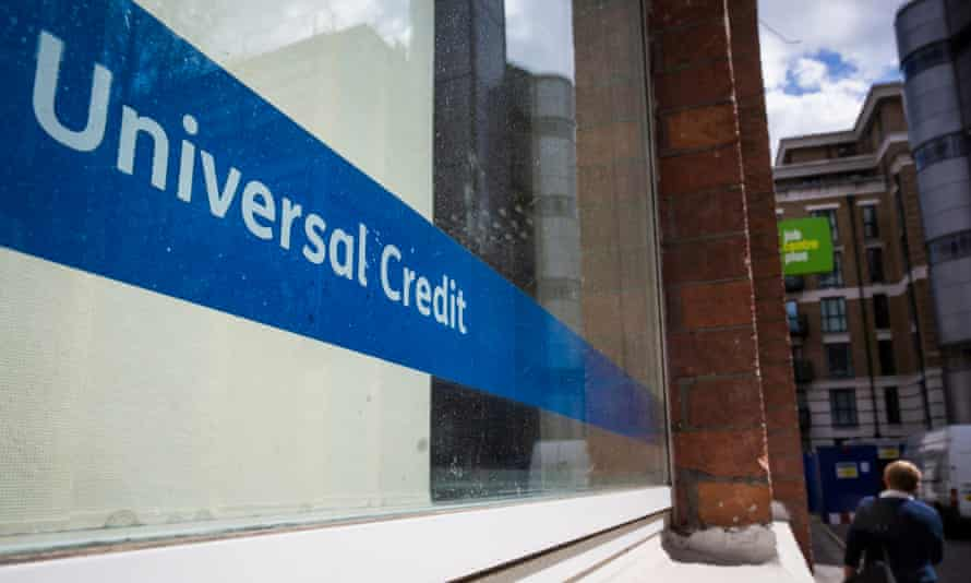 A universal credit sign in the window of the Jobcentre Plus in Westminster, central London.