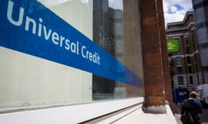 A universal credit sign in the window of a jobcentre.