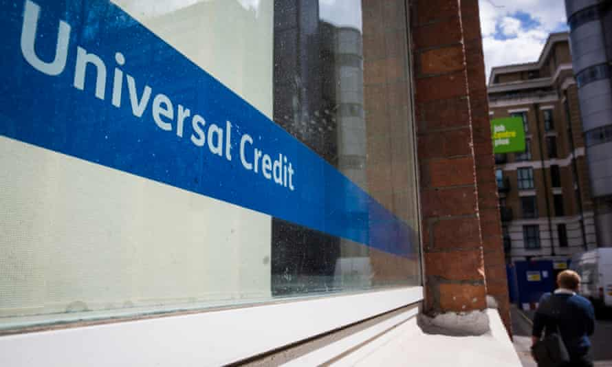 A Universal Credit sign in the window of the Job Centre in Westminster