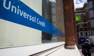 A Universal Credit sign in the window of the Job Centre in Westminster, London. Photo by Jack Taylor/Getty Images