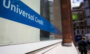 A universal credit sign in a jobcentre window