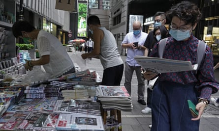 People queue to buy copies of Apple Daily after its owner, Jimmy Lai, was arrested. Hong Kong Free Press's editor says outlet has been targeted because of its 'fact-based coverage'.
