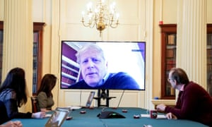 Boris Johnson chairs a meeting on coronavirus remotely from Number 11 Downing Street after testing positive for the virus