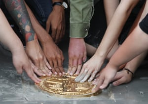 Pro-democracy student leaders install a plaque declaring 'This country belongs to the people' at the Sanam Luang field in Bangkok.