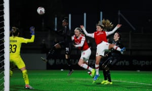 Arsenal's Danielle van de Donk heads in Arsenal's sixth goal against Slavia Prague to complete her hat-trick.