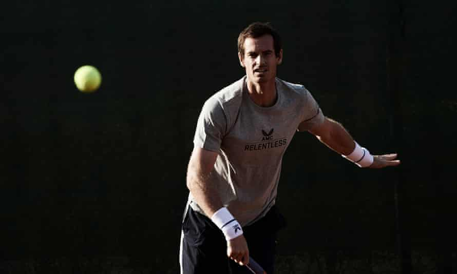 Andy Murray watches the ball after serving