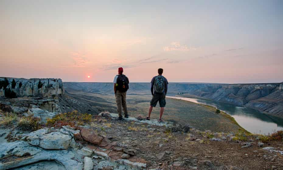 Tourists look out over the Upper Missouri river at Upper Missouri River Breaks national monument near Lewistown, Montana.