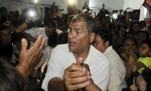 Rafael Correa greets his supporters in Guayaquil, Ecuador Monday.
