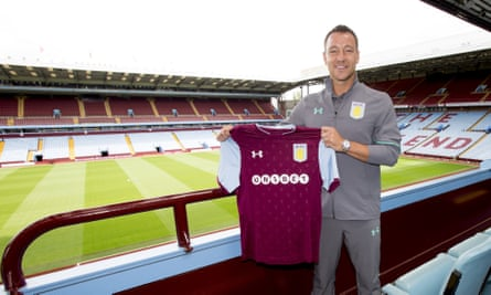 John Terry poses at Villa Park with his new team shirt.